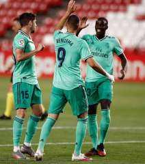 ريال مدريد يفوز على غرناطة ويتقى له خطوة على التتويج بالليجا