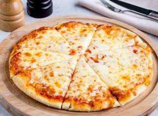 استشارات من الطهاة.. أفضل النصائح لتناول البيتزا بدون الإصابة بالوزن الزائد