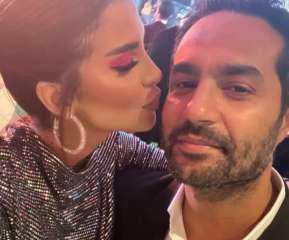 شاهد بالصور.. قبلات مثيرة متبادلة بين كريم فهمي وزوجته