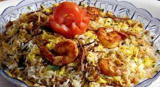 «زي المطاعم».. أسهل طريقة لتحضير الكبسة بالمأكولات البحرية