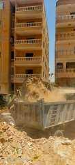 شاهد.. رفع 500 طن مخلفات من أراضي فضاء بهضبة الأهرام